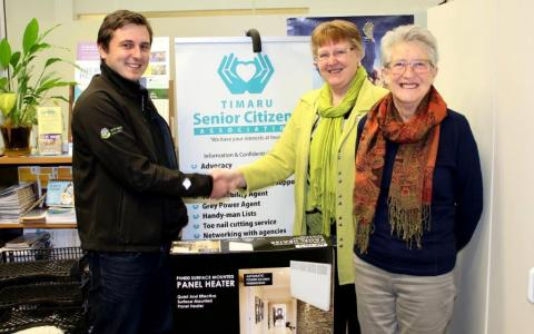 Comfortmaster consultant Sam Saunders donating two quality spot heaters to Timaru Senior Citizens Association